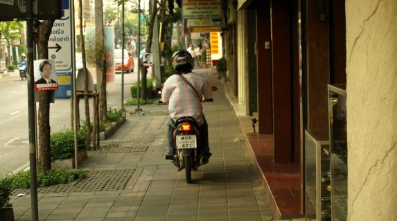 Motorcycle on Sidewalk in Thailand